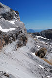 Cirque de Gavarnie in summer. The cirque de Gavarnie is a large rock amphitheater. The cirque's walls are twisted and layered. The cirque is bordered by several Royalty Free Stock Images