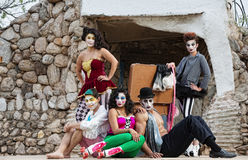 Cirque Performers on Stage. Group of male and female comedia del arte performers sitting on stage Royalty Free Stock Images
