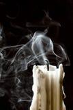 Ciérrese encima de vela con humo Imágenes de archivo libres de regalías