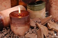 Ciérrese encima de velas sospechadas chocolate Imagen de archivo