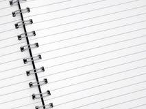 Ciérrese encima del papel alineado blanco en una libreta espiral. Imagen de archivo libre de regalías