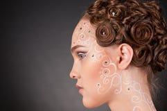 Ciérrese encima del retrato de la muchacha hermosa con arte de la cara Imagen de archivo libre de regalías