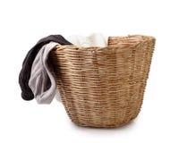 Ciérrese para arriba de la ropa interior masculina usada en la cesta aislada en el clip blanco Imagen de archivo libre de regalías