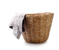 Ciérrese para arriba de la ropa interior masculina usada en la cesta aislada en el clip blanco Foto de archivo libre de regalías