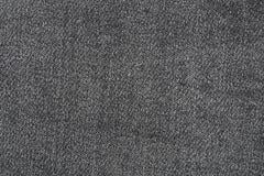 Ciérrese para arriba de textura negra de la mezclilla Fotografía de archivo