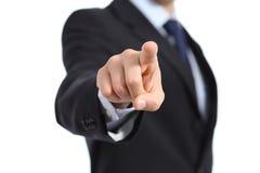 Ciérrese para arriba de una mano del hombre de negocios que señala en la cámara Imágenes de archivo libres de regalías