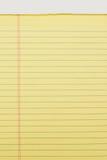 Ciérrese para arriba del cuaderno de notas amarillo aislado en el fondo blanco Imagen de archivo