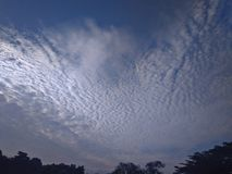 Cirrocumulus clouds. Formation of small puffy white clouds banded close together to resemble a mackerel sky & x28;looks like fish& x27;s scales& x29 Stock Photography