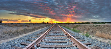 Cirrocumulus clouds in horizon meets the tracks in the center. Stock Photo