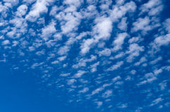 Cirrocumulus clouds spreading on blue sky Stock Photography