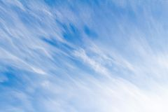 Cirrostratus clouds in blue sky stock photos