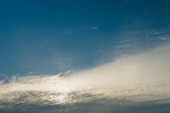 Cirrus and cirrocumulus clouds covering morning sun and sky Stock Photography