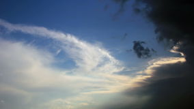 Cirrus cloouds. White and dark cirrus clouds on blue sky stock video footage