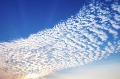Cirrus clouds. With colorful sky and Beam of sunlight Stock Images
