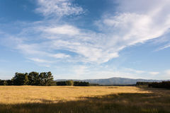 Cirrus clouds above rural countryside Royalty Free Stock Photos