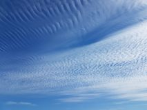 Cirrus clouds on a clear blue sky. Weather forecast. Water in a gaseous state in nature. The atmosphere of the earth. The effect o. F humidity on agricultural stock image