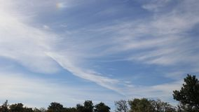 Cirrus clouds moving in blue sky. Filmed in timelapse stock video
