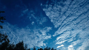 Cirrus Clouds Moving Over the Village. In the Light of a Sunset stock footage