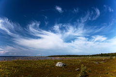 Cirrus clouds over the beach and the sea of the North. Solovetsky island, White Sea Beluga cape Stock Photography