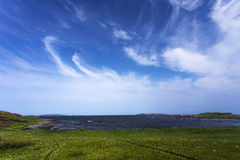 Cirrus clouds over L'Anse aux Meadows, Newfoundland royalty free stock images