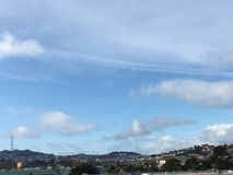 Cirrus clouds over San Francisco`s Twin Peaks, with Sutro Tower. The whispery cottony looks of cirrus clouds are fun for picking out designs. The name `cirrus` royalty free stock image