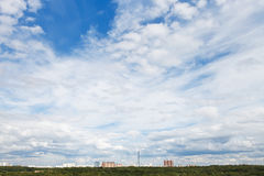 Cirrus and cumuli white clouds in over city. In summer day Royalty Free Stock Photo