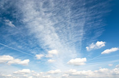 Cirrus and cumulus clouds in the blue sky. Stock Images