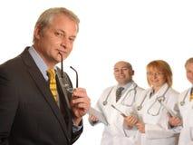 Cirujano con las personas médicas Foto de archivo libre de regalías