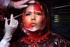 Cirurgia plástica criativa no modo vermelho de Tone Fashion Patient Female Foto de Stock Royalty Free