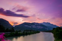 Trento, italy. The ciry of Trento in Italy as seen from one of its many bridges during the blue hour, just after  sunset Royalty Free Stock Photos