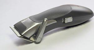Cisaillements de cheveux ou fond électriques de blanc de coupeur Image stock