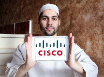Cisco logo. Logo of cisco company on samsung tablet holded by arab muslim man Stock Photography