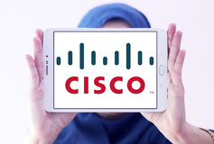 Cisco logo. Logo of cisco company on samsung tablet holded by arab muslim woman Stock Photography
