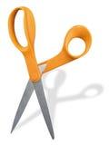 Ciseaux avec les traitements oranges Photo stock