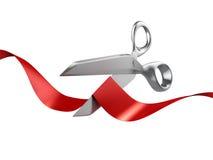 Ciseaux coupant la bande rouge Image stock