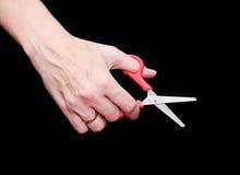 Ciseaux dans la main femelle Photos libres de droits