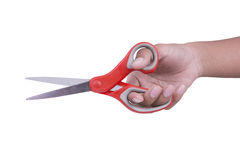 Ciseaux de prise de main sur le fond blanc image stock
