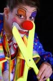 Ciseaux et clown de plastique photos stock