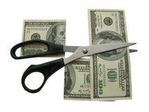 Ciseaux et dollars. Images stock