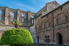 Right side of the Abbey of San Galgano with the entrance to the Chapter House royalty free stock photo