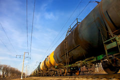 Cistern by rail. Oil transportation in tanks by rail royalty free stock images