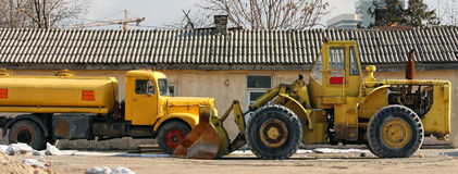 Cistern truck and bulldozer Stock Photo