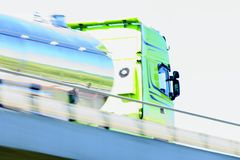 Cistern truck on highway with reflections stock images
