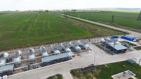 Cisterns Filled with Gasoline Stand on Driveways near Plant. Panoramic view oil tank cars filled with gasoline stand on driveways near refinery plant against stock video