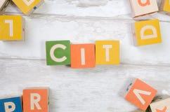 Cit-ord med färgrika kvarter Arkivbild