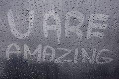 Citações inspiradores na janela Foto de Stock