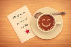 Cita en el papel con la taza de café Imagen de archivo