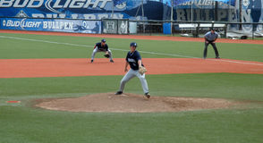 Citadal Pitcher fires a ball towards homeplate Royalty Free Stock Images