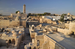 Citadel of Aleppo. The Citadel of Aleppo is a large medieval fortified palace in the centre of the old city of Aleppo, northern Syria Stock Photography