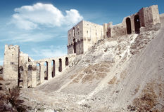 Citadel of Aleppo. Syria: Citadel of Aleppo. The Citadel of Aleppo  is a large medieval fortified palace in the centre of the old city of Aleppo, northern Syria Stock Images